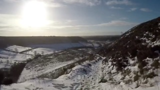 Snow Blankets York's Hole of Horcum During Man's Midday Run - Video