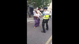 Funny scene as Irish police dances with Africa Day attendees - Video