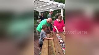 Children customise table with family pictures for father - Video