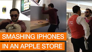Angry Customer Smashes iPhones With Metal Ball In Apple Store - Video