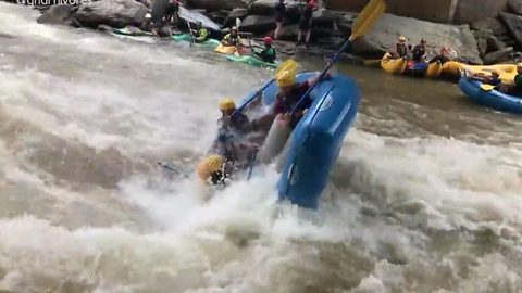 A whole raft of problems: Boatload of passengers go flying as raft hits river rapids