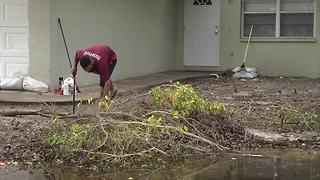 Residents cleaning up after flooding - Video