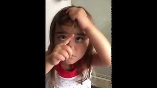 3-year-old explains why she cut her bangs - Video