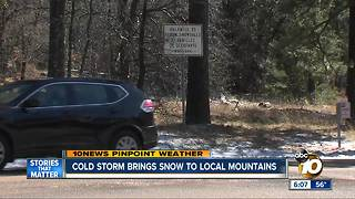 Cold storm brings snow to local mountains - Video