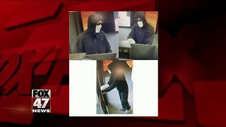 Police searching for man who robbed a south Lansing bank