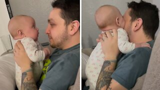 Teething baby literally tries to eat daddy's nose