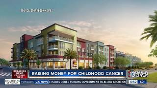 New apartment complex raises money for children fighting cancer - Video