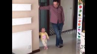 Cute toddler mimics dad's posture - Video