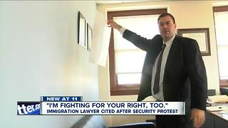 Immigration lawyer cited after security protest - Video