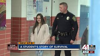 Officer, school employee save student's life - Video