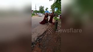 Two Buddhist monks caught fighting in Myanmar - Video