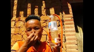 This Chinese man can drink through his ears - Video
