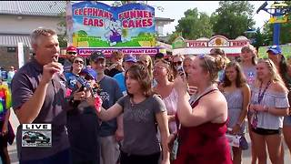 Brian Gotter tries ants at the State Fair