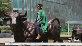 Seventeen year old graduates from USF
