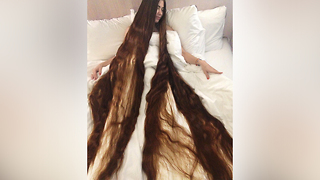 Real-Life Rapunzel Has 90 Inch Long Hair And Is Proud Of It - Video
