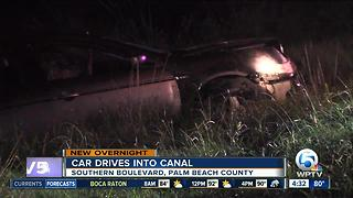 Car drives into canal along Southern Boulevard - Video