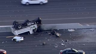 Rollover causing backup on US-95 near Spaghetti Bowl - Video