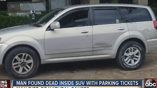 Man found dead inside SUV with parking tickets piled on windshield - Video