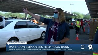 Raytheon teams up with food bank in drive-thru food donation event