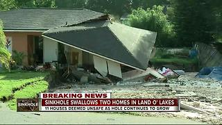 Sinkhole swallows two homes in Land O' Lakes - Video