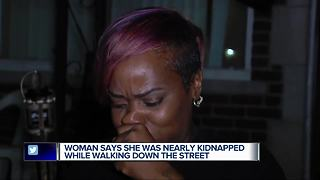 Woman says she was nearly kidnapped while walking down the street
