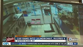 SUV slamming into laundromat caught on camera - Video