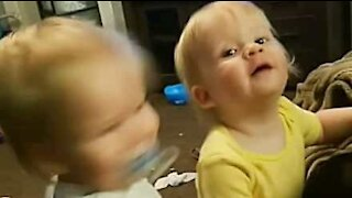 Twin babies love rocking out to heavy metal!