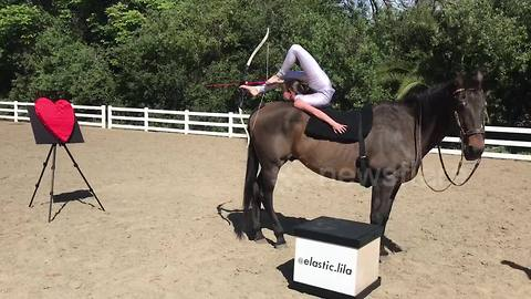 Kid contortionist performs foot archery on horseback