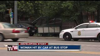Woman hit by car at Indy bus stop - Video