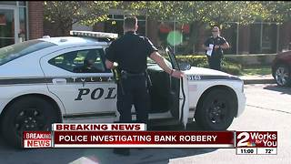 Police investigate bank robbery in north Tulsa - Video