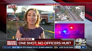 Suspect shot by police at scene of house fire - Video