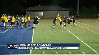High school football season returns with midnight practice in Commerce Township