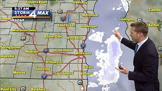 Cloudy Tuesday morning, stray flurries possible
