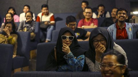 Touching photographs show inside world's first 'whisper cinema' where blind people get the movie experience by being described it by their friends