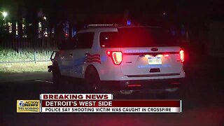 Police say shooting victim was caught in crossfire