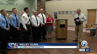 Paramedics honored for saving woman - Video