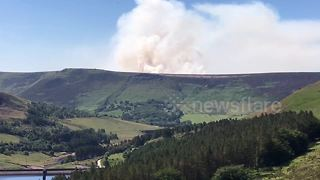 Fire sends huge plume of smoke into skies over Saddleworth Moor - Video