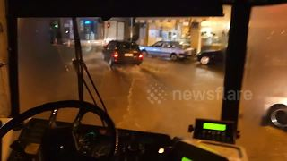 Bus becomes a boat as it drives through flooded streets in Greece - Video