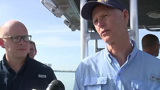 Governor Scott talks to media after tour of algae in the Caloosahatchee