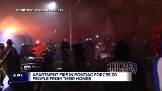 Apartment fire in Pontiac forces 20 people from their homes - Video