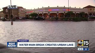 Massive water main break hits north Phoenix strip mall - Video