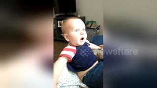 Baby has adorable reaction to dad shaving his beard - Video