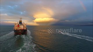 Drone films tanker ship sailing into dramatic Northern Ireland sunset