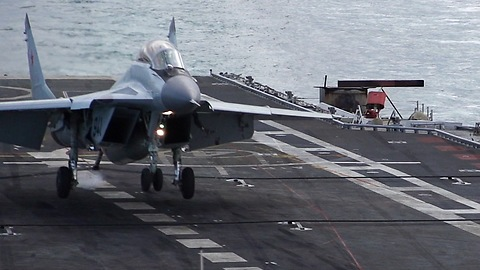 Slow Motion Footage Captures Jet Fighter Landing On Aircraft Carrier