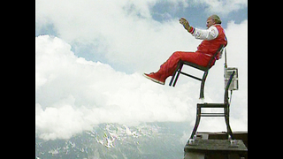 Guy Balances Chair Over Precipice