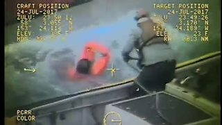 Fishing vessel captain rescues fellow crewmen - Video
