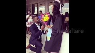 Man surprises girlfriend with marriage proposal on her graduation day - Video