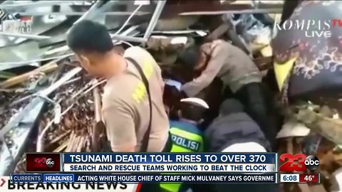 Tsunami death toll rises