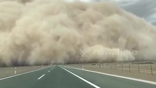 Sandstorm hits northern China - Video