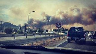 Smoke Rises Over Corsica from Wildfire - Video